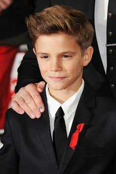 ROMEO Beckham 11 and already a model. This is not ok.