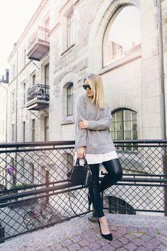 Linda Juhola in over sized grey knit from Samsøe & samsøe with white Mango shirt peeking from underneath. Black shoes Mango, Ray Ban sunglasses and Louis Vuitton bag