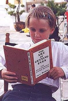 how cute is this little malfoy with his book.... of how to get even? lol