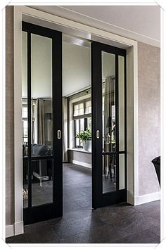 Pocket doors or sliding doors with black trim to offset the rest of the white trim and white fireplace. French Pocket Doors, French Doors, Glass Pocket Doors, Glass Entry Doors, Glass Office Doors, Double Pocket Door, Glass Barn Doors, Entrance Doors, Style At Home