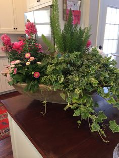 Spring arrangement in wooded dough bowl
