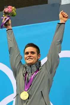 Gold medalist David Boudia celebrates on the podium during the medal ceremony for the men's 10m platform diving.