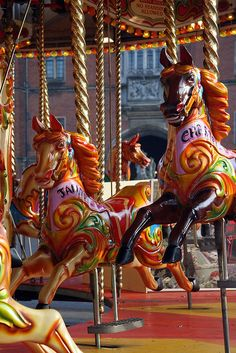 This extremely colorful carousel is in England and is also going in the wrong direction.