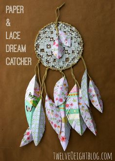 Paper + lace dream catcher for Abbie's room  Super cute lace dream catcher with paper feathers.