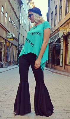 Extravagant flared pants made of a very soft jersey, easy to wear, extremely comfortable and fun. Funky flared pants that will for sure steal the spotlight! Material: 50% cotton, 50% polyester Care instructions: Wash at 30 degrees The model in the picture is size S. Can be made in ALL SIZES. If you have any other specific requirements, do not hesitate to contact me! I DO NOT CHARGE EXTRA MONEY for custom made items. All you need to do is send me your measurements. Below, you will find a table wi Black Flare Pants, Black Pants, 30 Degrees, Extra Money, Spotlight, Custom Made, Bell Bottom Jeans, Table, Easy