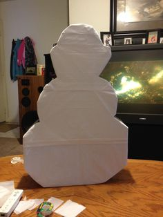 Here I completely covered Olaf in white tissue paper.