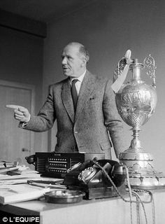 Matt Busby in his Manchester United office during the season. The league championship trophy sits on his cluttered desk. Manchester United Images, Manchester United Legends, Manchester United Football, School Football, Sport Football, Matt Busby, Man Utd Fc, Bobby Charlton, Association Football