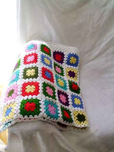 MADE TO ORDER Order processing time 3-5 days. crochet afghan blanket, granny square blanket color: primary color white, multicolor for pattern size widthx lenght 95cmx95cm (37.4x37.4) *************************************************************************** Other blanket options https://www.etsy.com/shop/crochets4world?section_id=18885681&ref=shopsection_leftnav_10