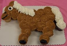 horse cupcake cake! SO CUTE  This website has 11 pages of cupcake cake designs