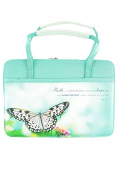 This micro-fiber #Bible cover includes a screen printed #butterfly and #flowers on aqua background. The purse-style #BibleCover includes handles and wrap zipper closures. Inside is a mesh zippered pocket and a loop for your pen. Outside are two convenient slip pockets.