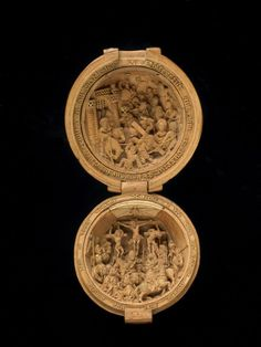 Rosary bead or prayer-nut; boxwood; opening in two halves, each with carved subject in full relief; Bearing of the Cross, procession issuing from a gateway with portcullis; in the lower half, Crucifixion with crowd of figures; some details of carving and inscriptions gilt; outside pierced with pear-shaped openings containing quatrefoils; inscribed. Date 1490-1530  © The Trustees of the British Museum