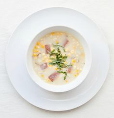 Williams-Sonoma Quick Corn Chowder: Saute minced shallots in butter until softened. Add corn kernels, diced potatoes, chopped thyme, chicken or vegetable broth, salt and pepper; cook until potatoes are tender. Stir in half-and-half and chopped basil.