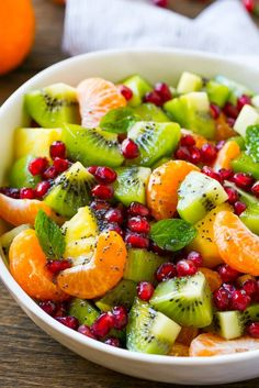 This winter fruit salad is a colorful variety of fresh fruit tossed in a light honey poppy seed dressing. This winter fruit salad is a colorful variety of fresh fruit tossed in a light honey poppy seed dressing. Winter Fruit Salad, Best Fruit Salad, Fruit Salad Recipes, Christmas Fruit Salad, Fruit Salads, Christmas Fruit Ideas, Thanksgiving Fruit Salad, Fresh Fruit Desserts, Kiwi Recipes