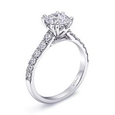 A beautifully tailored engagement ring featuring diamonds down each side of the shank. Built for a 1CT center stone. Copy. #coastdiamond