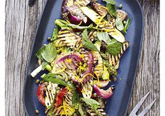 Tossed in a fragrant marinade, this glorious barbecued vegetable salad is packed full of char-grilled eggplant, zucchini, asparagus and onions to create a brilliant side dish, perfect to go alongside roasted meat. Grilled Eggplant, Grilled Tomatoes, Grilled Zucchini, Eggplant Zucchini, Shish Kebab, Kebabs, Skewers, Grilling Sides