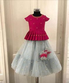 A light grey and pink peplum ghagra detailed with net Pom Pom's… Girls Frock Design, Kids Frocks Design, Baby Frocks Designs, Baby Dress Design, Kids Dress Wear, Kids Gown, Kids Wear, Frocks For Girls, Dresses Kids Girl