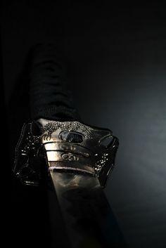 "Japanese sword -katana-. The art of war. Sun Tzu said: ""According as circumstances are favorable, one should modify one's plans."""