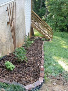 Lining garden beds with red brick