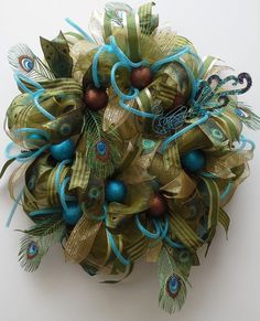 Fall or holidays deco mesh wreath with fabulous peacock theme.  Turquoise glitter and satin ornaments with gold, moss green, blue ribbons. on Etsy, $129.00