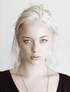 She shares the ancient Queen's white blonde hair, pale eyes (though hers are silverish gray and Keena's was blue) and striking features.