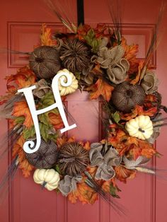 Fall wreath with initial for autumn. I love the fall colored leaves, pumpkins, and burlap.