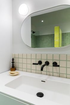 Green tile galore 💚✨ These homeowners had fun with the tile in their bath, mixing matte and glossy tile in a range of sizes and colors, including chartreuse, dark green, and gray-green. What's your dream tile color? Wall Mounted Toilet, Wall Mounted Vanity, Life Space, Door Trims, Radiant Heat, How To Level Ground, Wall Spaces, Shelving, Storage