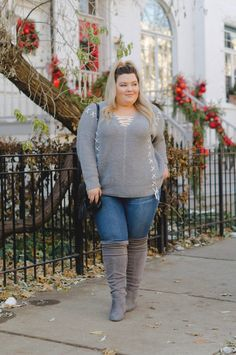 Chicago Plus Size Fashion Blogger Natalie Craig reviews Charlotte Russe's tummy control skinny jeans, wide calf over the knee faux suede boots, and lace up pullover sweater.