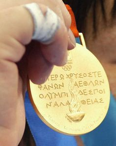 Close-up of the back of a gold medal from the 2004 Athens Olympic Games.