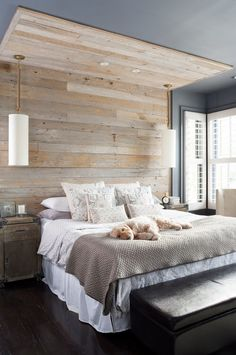 Planked wall behind bed