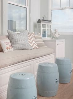 Window seat with coa Window seat with coastal pillows. Neutral window seat with coastal pillows and blue garden stools. Beach Cottage Style, Coastal Cottage, Beach House Decor, Coastal Style, Coastal Decor, Home Decor, Coastal Living, Coastal Entryway, Coastal Rugs