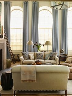 Soft greens and blues....mostly in love with the large window and tall ceilings. The curtains elongate the ceiling even more.