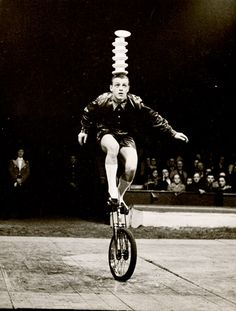 Unicycling plus teacup balancing