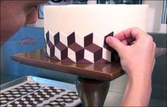 Video tutorial with info and instructions on how to decorate an optical illusion cake with modeling chocolate by Wicked Goodies Fondant Cake Tutorial, Fondant Flower Cake, Fondant Cakes, Cupcake Cakes, Cupcakes, Fondant Bow, Fondant Figures, Cake Decorating Techniques, Cake Decorating Tutorials