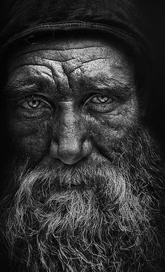 Elders face with no tribal adornments not specific to religion or culture. Simply human.