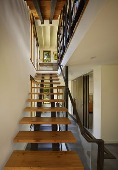 Magnificent Steel Stairs Residential Ideas in Staircase Modern design ideas with bookcase concrete floor dark stained wood douglas