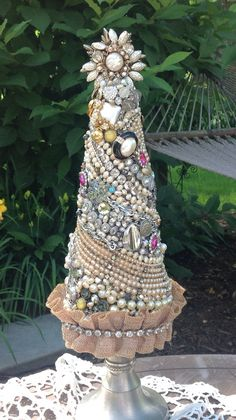 One of a kind jewelry Christmas Tree. Tree stands 16 tall and is adorned with pearls, rhinestones, and other vintage pieces. Jeweled Christmas Trees, Cone Christmas Trees, Christmas Tree Crafts, Christmas Jewelry, Holiday Crafts, Christmas Decorations, Christmas Ornaments, Cone Trees, Costume Jewelry Crafts