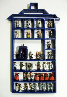Doctor Who figures in a TARDIS.wonder if hubby could build this for me. :)