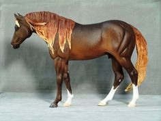 Resin model horse Ladino Bueno by Alicia Strayer-Mangan. (Thankss, Donna, for the info!)