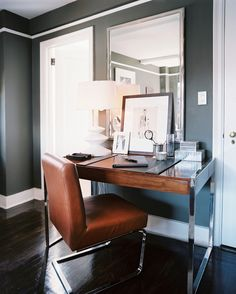 Masculine Chic . . . Muted, earthy colors and sleek metal accents transform this home office for the modern bachelor