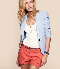 red/orange shorts with a blue striped blazer.