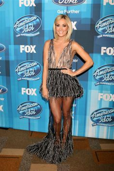 """Carrie Underwood showed a lot of skin in a Yanina Couture confection with a plunging neckline and a sheer skirt during the """"American Idol"""" finale in Hollywood, California, on April 7, 2016."""