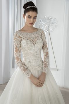 Romantic, long-sleeved ball gown with an off-the-shoulder beaded lace neckline…