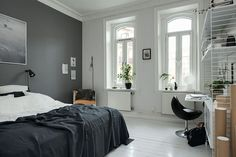 Bedroom with a grey wall - via http://cocolapinedesign.com