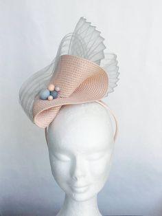Use felted balls for modern hat decor