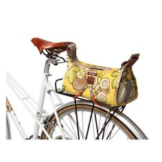 What a clever idea!  This Pilsen Bungee Bag by Po Campo has little bungee cords as part of the bag design, and can easily attach to the front handle bars or your bike rack in the back.