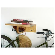 Made from solid ash wood, the Saddle Up Bike Rack is stylish and unique. Store your essentials on the handy shelf while keeping your bike secure and your living space clutter free with convenient cutou...  Find the Saddle Up Bike Rack, as seen in the The Modern Outdoorsman Collection at http://dotandbo.com/collections/the-modern-outdoorsman?utm_source=pinterest&utm_medium=organic&db_sku=98625