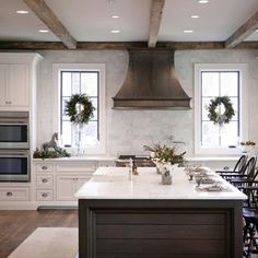 Bell Kitchen and Bath Studios - traditional - kitchen - atlanta - Barbara Brown Photography- Range hood between windows