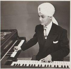 Turning on the TV in Los Angeles in 1949, you might have come face-to-face with a young man in a jeweled turban with a dreamy gaze accentuated by dark eye shadow. Dressed in a fashionable coat and tie, Korla Pandit played the piano and the organ—sometimes both at once—creating music that was both familiar and exotic. According to press releases from the time, Pandit was born in New Delhi, India, the son of a Brahmin government worker and a French opera singer. A prodigy on the piano, he…