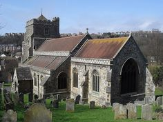 """All Saints Church, Old Town, Hastings The medieval town's """"upper church"""", so called because of its hilltop position, is an early 15th-century Perpendicular Gothic structure of rubble and flint. William Butterfield's restoration of 1870 included a large east window. Titus Oates was a curate in the 17th century."""