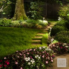 When landscape lighting doubles beautifully as path lighting and area lighting for a garden. Pin this quaint and practical technique!